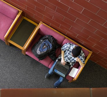 looking down on student with laptop