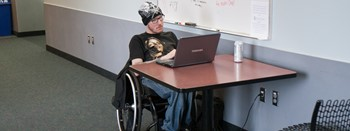 student in wheelchair studying