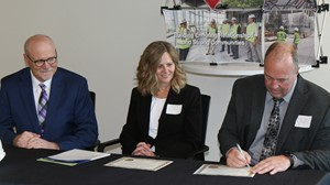 (from left) Al Gerhardt, Kraus-Anderson Construction Company Chief Operating Officer and President, Jodie Greising, Director of MJSP and Kent Hanson, Anoka-Ramsey Community College President, sign a $394,279 Minnesota Job Skills Partnership (MJSP) grant that will allow the college to provide customized training and development to 500 employees at Kraus-Anderson.