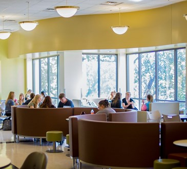 Students seated in campus dining area.