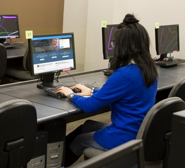 student at computer in testing center