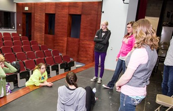 students on theatre stage